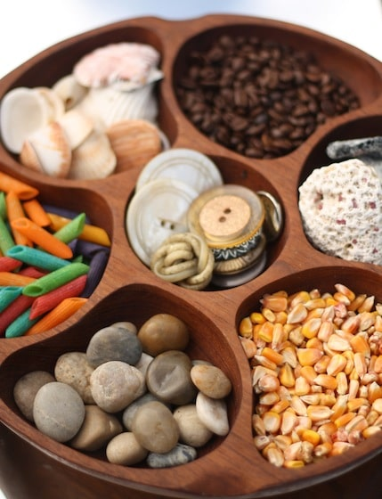 "Present sensory materials in a wooden ""lazy susan""."