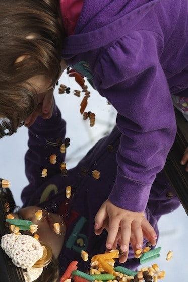 children discovering themselves in the mirrored sensory table
