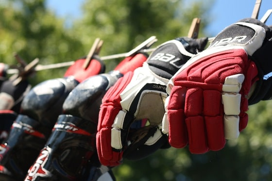 hockey gloves washed in the machine and drying on the line
