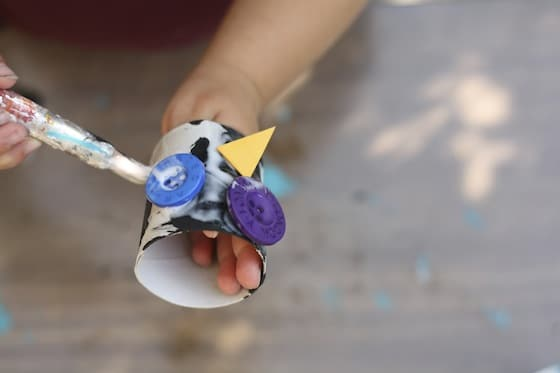 applying more glue to the owl