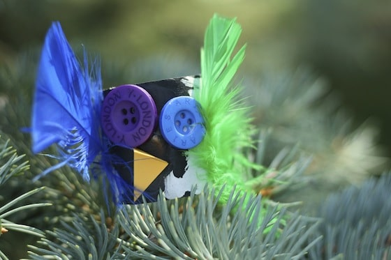 black halloween owl with blue and green feathers