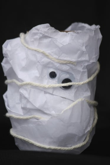 toilet roll mummy wrapped tissue paper and yarn