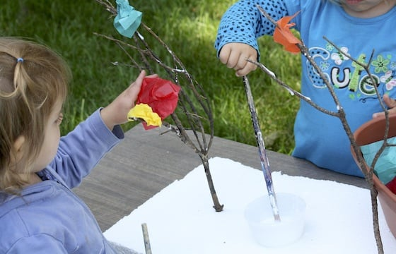 kids painting glue on twigs