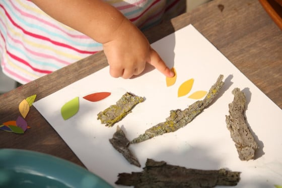 """gluing fall paint chip """"leaves"""" to our project"""