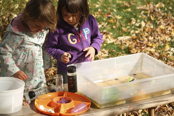 kids working together to melt ice with water using science