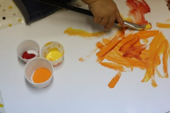 toddler mixing paint colours