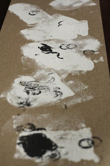 stamped halloween ghosts with sponges and corks