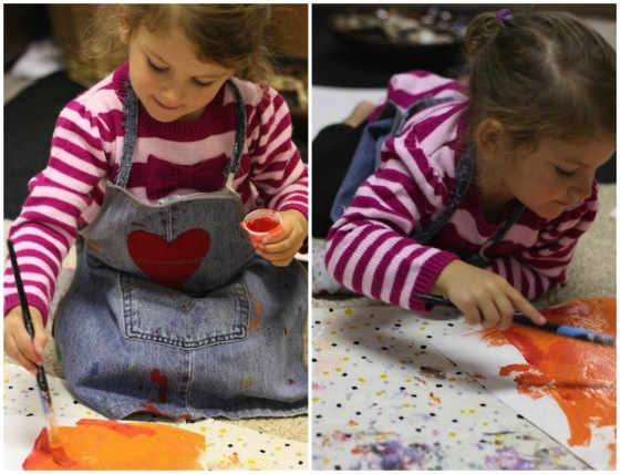 preschooler Painting Pumpkins - a lesson in colour mixing