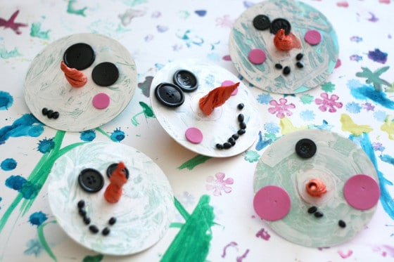 5 unique snowman ornaments made from old CDs