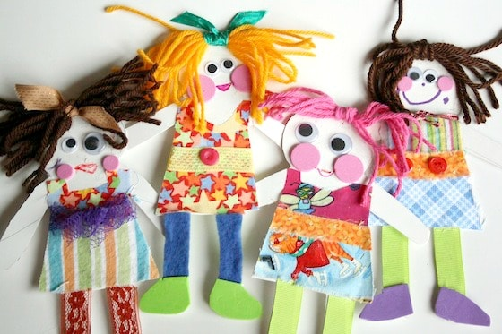 paper dolls made from cardboard and fabric scraps