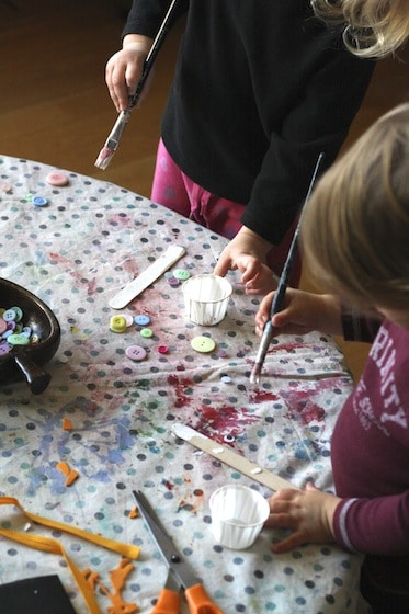 painting craft sticks for snowman ornaments