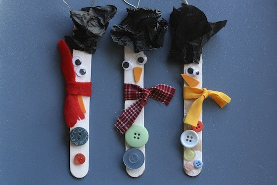 craft stick snowman ornaments with tissue paper hats