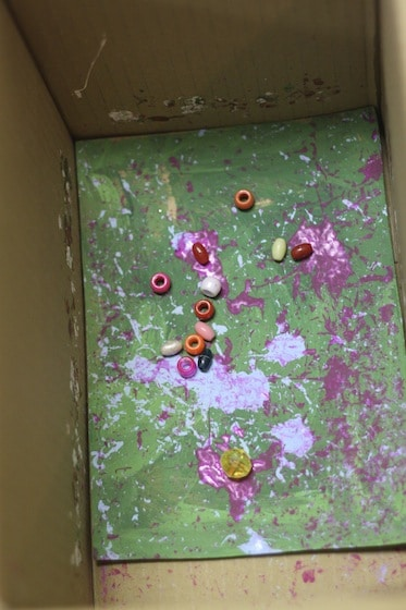 pony beads and paint in a cardboard box