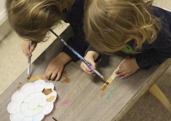 "painting craft stick ""tree trunks"""
