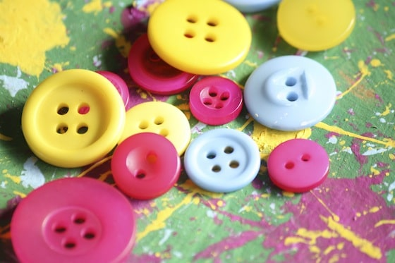 Colourful buttons and paint for button christmas tree ornaments