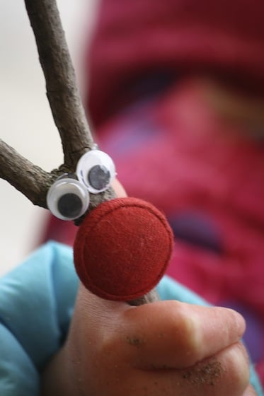 close up of twig reindeer with large red button nose and google eyes
