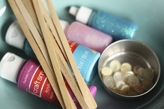 supplies for snowflake ornaments with craft sticks and buttons