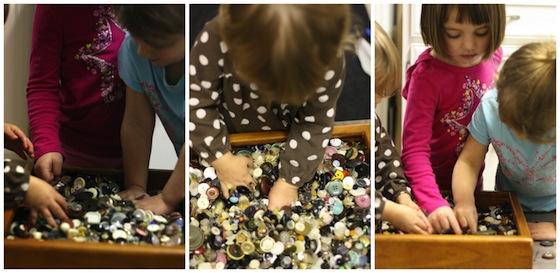 playing in a box of buttons