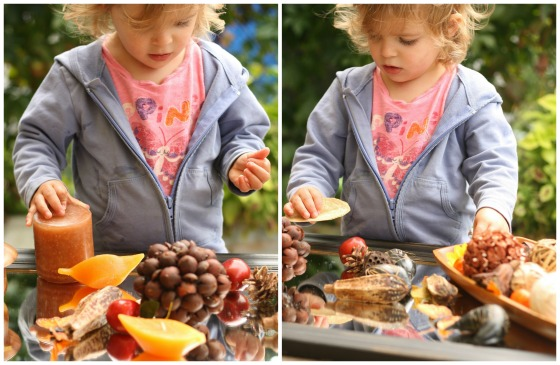 toddler exploring Fall Sensory Table