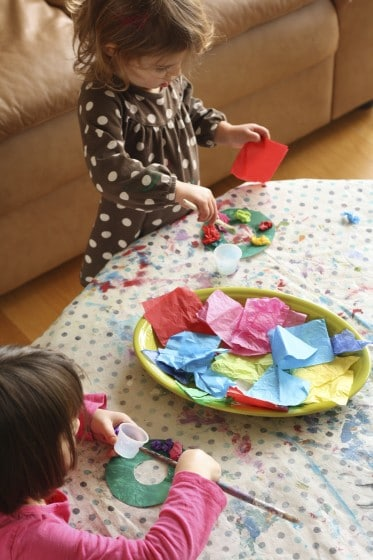 kids making tissue paper wreath ornaments
