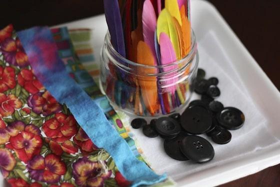 sensory materials as supplies for snowman art project