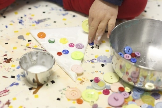 gluing buttons on styrofoam tree ornaments