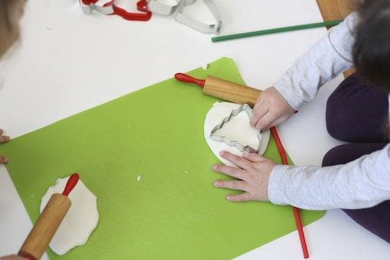 kids making white clay dough ornaments for the christmas tree