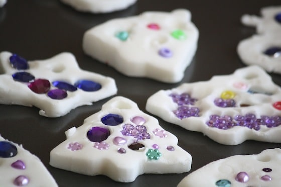 clay dough ornaments transferred to dry on a cookie sheet