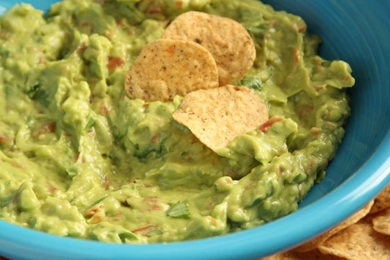 homemade guacamole in blue bowl