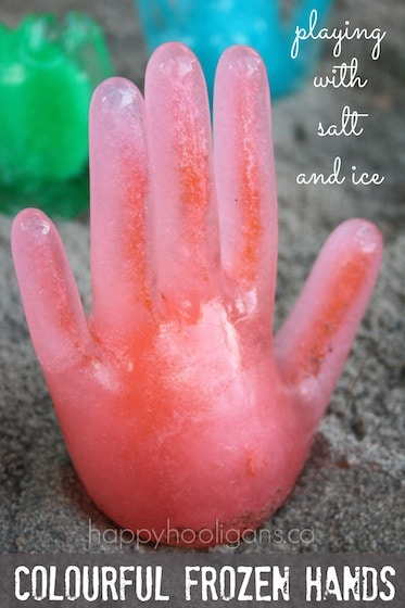 Colourful, frozen hands, playing with salt and ice