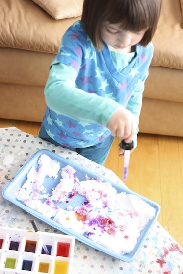 using a medicine dropper and liquid watercolours to colour the snow