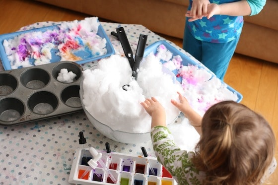 large bowl of snow and tray of liquid watercolours