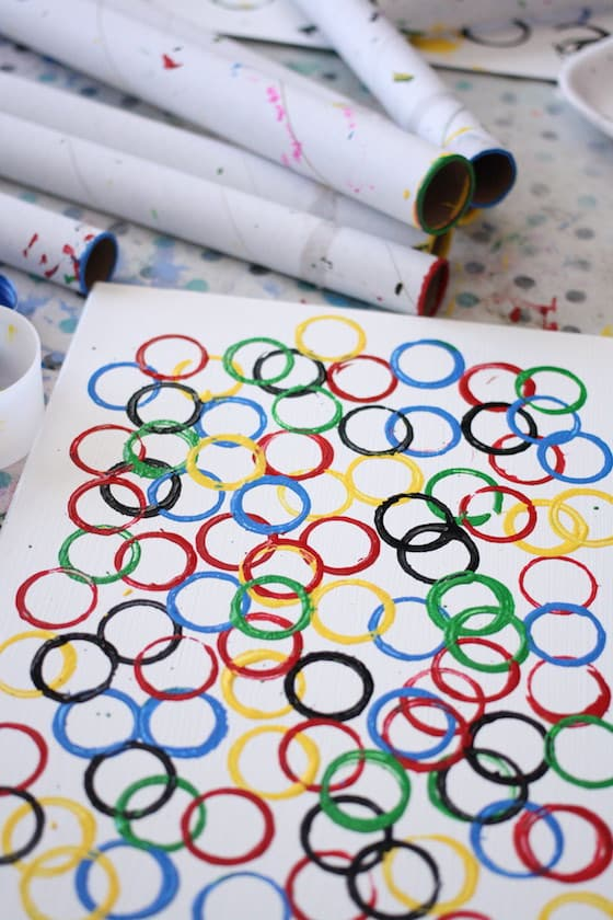 red, yellow, blue, green, black circles stamped by preschooler