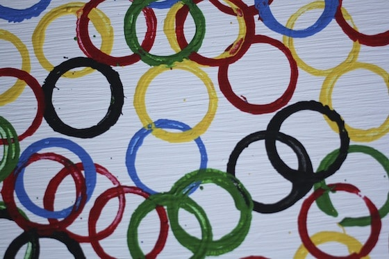 Olympic rings stamped with cardboard tubes.