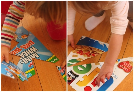 toddlers putting together homemade puzzles made from cereal boxes