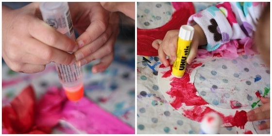 gluing tissue paper to cardboard hearts
