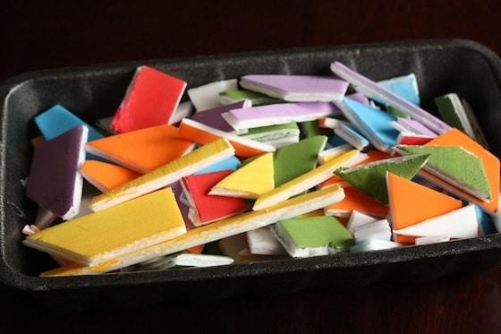 painted styrofoam meat tray cut into irregular shapes