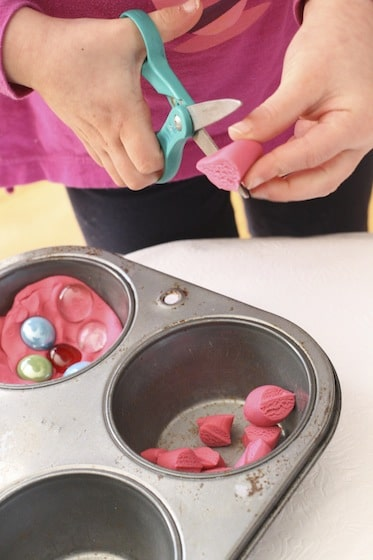 cutting play dough with scissors