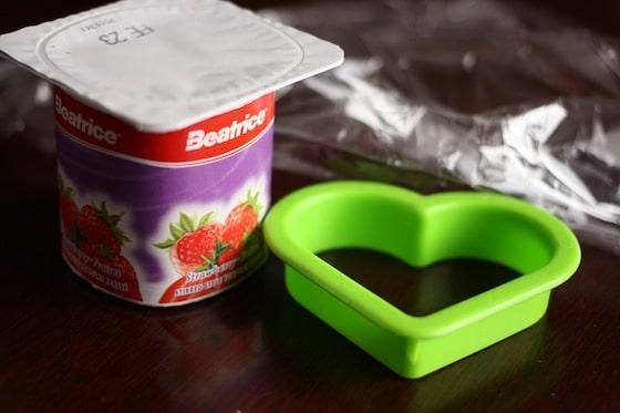 yogurt, cookie cutter and plastic wrap