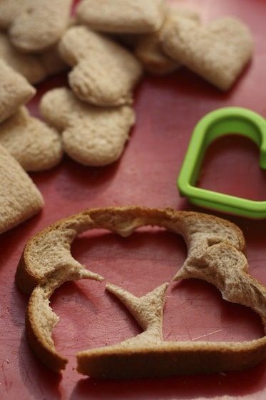 Cookie cutter and bread slices to make heart shaped french toast.