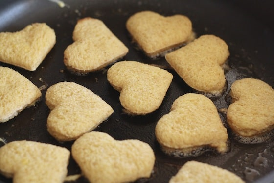Frying French Toast hearts in butter.