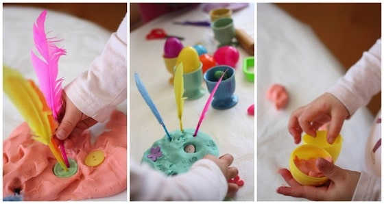 decorating easter playdough with feathers and buttons