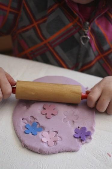 rolling foam flowers in playdough