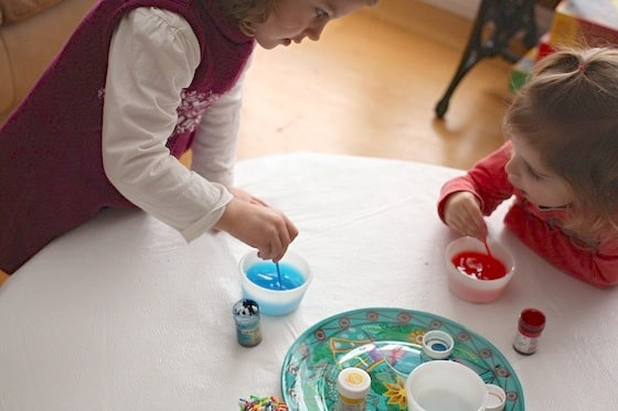 children mixing food colouring and water