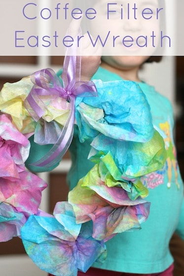 Kids spring wreath for Easter made with coffee filters and paper plates.