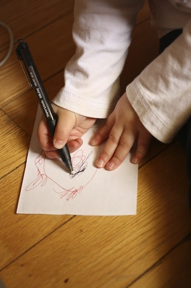 toddlers drawing ladybugs before making their craft