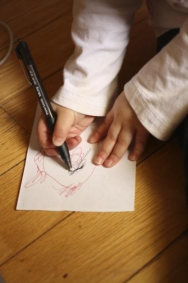 toddler drawing ladybugs before making their craft