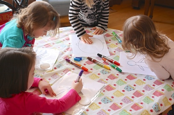 kids drawing on reusable plastic page protectors