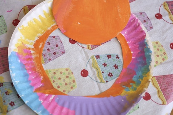 painted paper plate with centre cut out