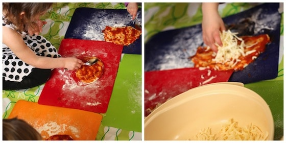kids putting sauce and cheese on their homemade pizzas